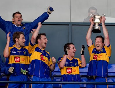 Gaels captain Barry Darcy holds the cup aloft